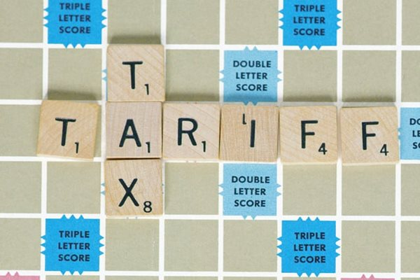 Tariff and Tax spelled on a Scrabble board